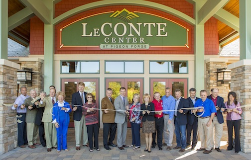 Almost two dozen dignitaries cut a gold ribbon to open the LeConte Center at Pigeon Forge after announcement of the facility's first major athletic event.