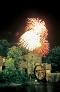 Patriot Festival fireworks fill the night sky above the Old Mill in Pigeon Forge.