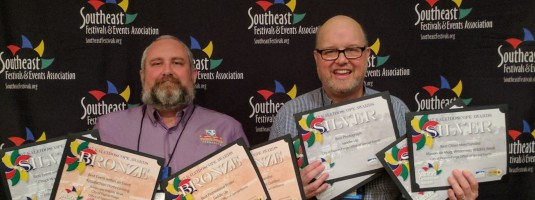 Pigeon Forge Special Events Dept. Coordinator (left) and Pigeon Forge Special Events Manager Butch Helton (right) carried home eight awards from the Southeast Festivals and Events Association awards ceremony in Lexington, Ky., in recognition of the city's special events.